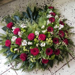 Memorial wreath with red roses