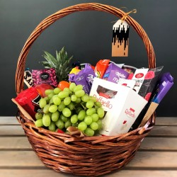Basket with fruits and sweets