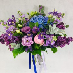 Bridal bouquet with purple...