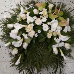 Memorial wreath with white...